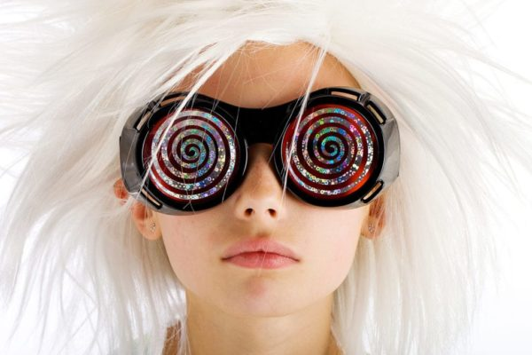 girl with white hair and black glasses with spiral pattern