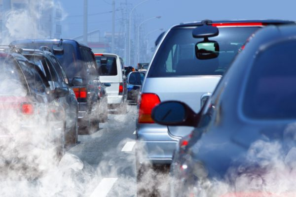 line of cars on road in pollution