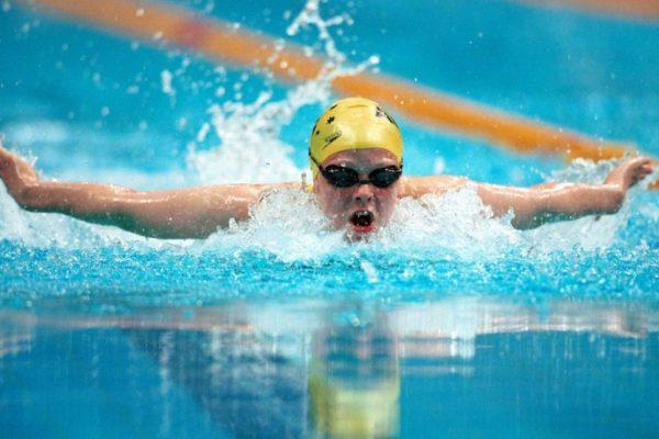 person swimming in a lane